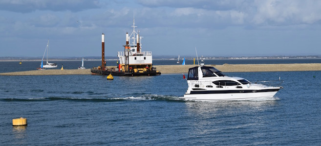 Motorboat passes Cowes Breakwater