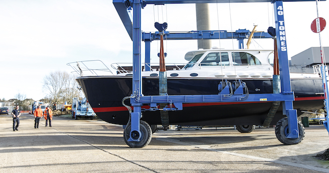 Boat in hoist at Cowes Harbour Services yard
