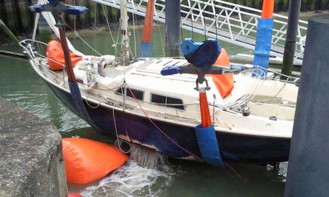 Salvage and Towage holed yacht in slings with airbags at Kingston