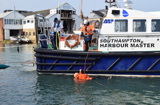 Pilot boat crew rescue pilot from water