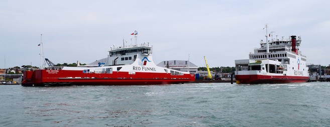 Red Funnel freight ferry in lay-by berth and vehicle ferry at East Cowes Terminal berth